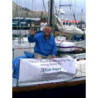 Trevor Nunn on his boat with the 'Kids Inspire' banner