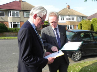 Stephen Robinson and Norman Lamb MP out canvassing